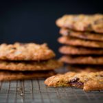 Cranberry Chocolate Chip Cookies stacked on cooling rack